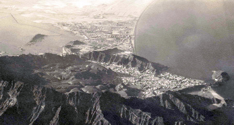 Aerial view of Crater town in the hollow of an extinct volcano. In the distance is RAF Khormaksar.