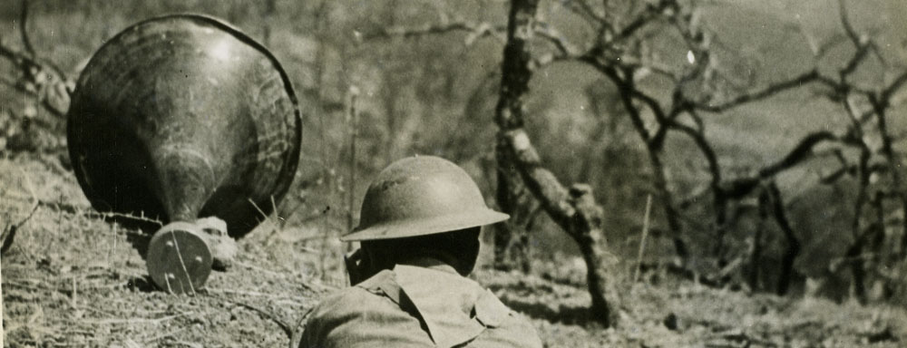A British soldier speaks through a loudspeaker to Japanese troops in Burma