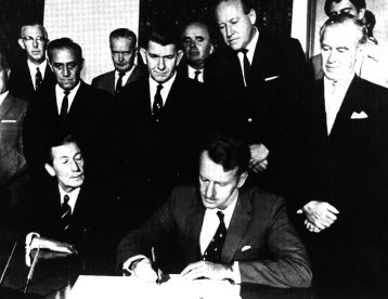 Prime Minister Ian Douglas Smith signs the Unilateral Declaration of Independence