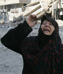 Wailing Arab woman outside her allegedly bombed home on 26 July 2006.