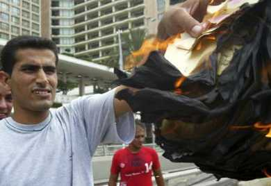 A Lebanese man burns Israeli air dropped leaflets