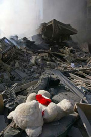 Pristine teddy bear amongst bomb damage in Lebanon