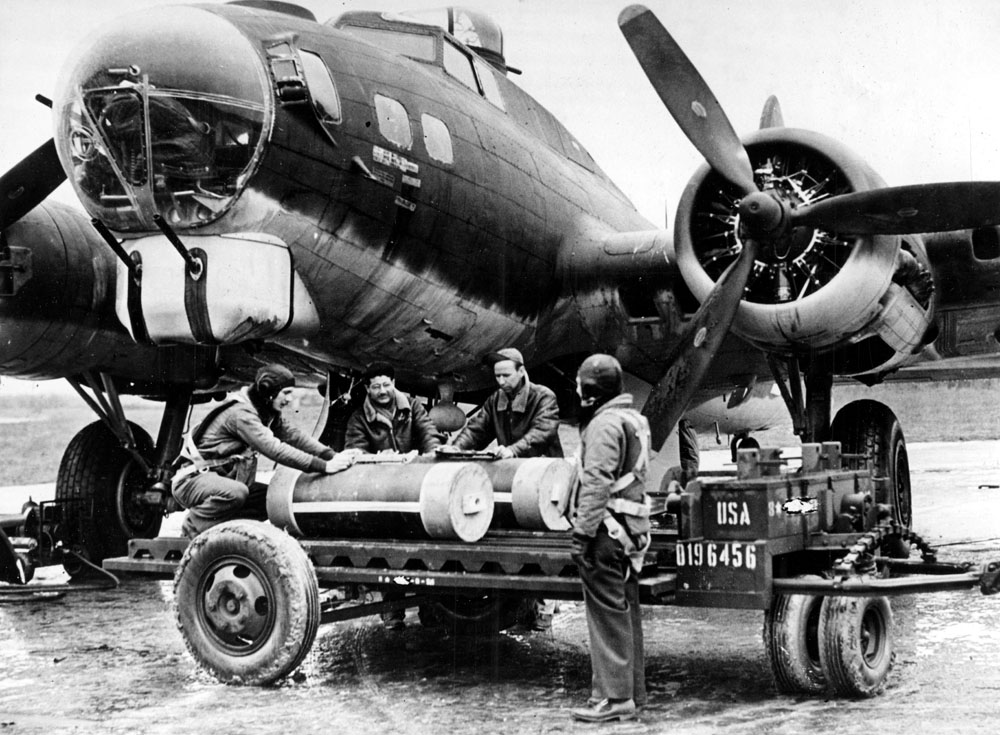 Monroe leaflet bombs being loading on to a heavy bomber for dropping over Europe