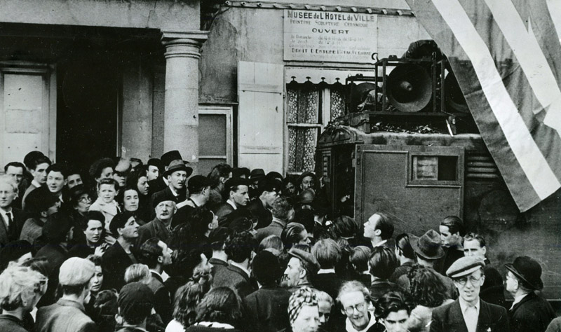 An Allied broadcast truck in the centre of Cherbourg after the town's liberation