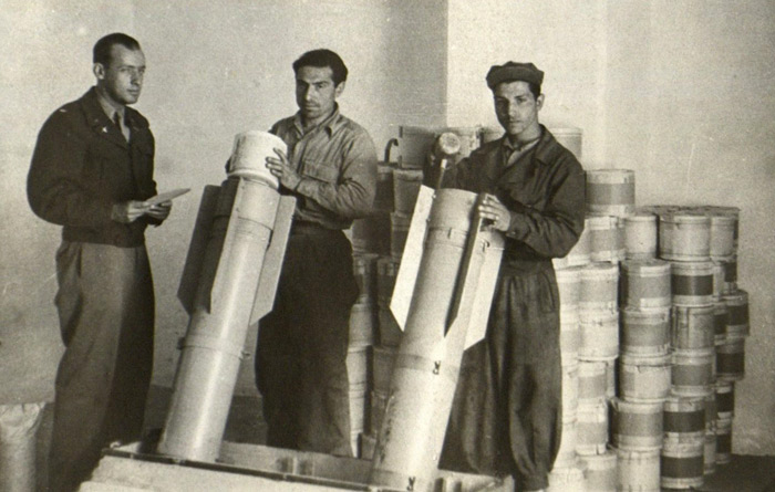 Operation Pig Iron: Loading rolls of miniature Das Neue Deutschland newspapers in to leaflet bombs