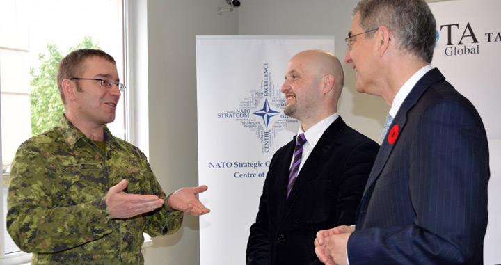 Latvian State Secretray and Canadian Ambassador speaks with Canadian Officer