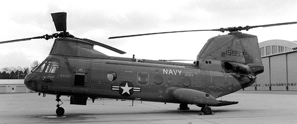 A left side view of an HH-46A Sea Knight helicopter equipped with the 1400-watt AEM-SYS-2 sound system and related loudspeaker, visible here on the helicopter's exterior left front