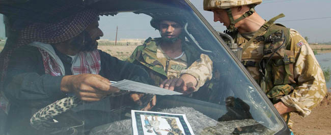 Iraq: British soldiers handing out information leaflets.