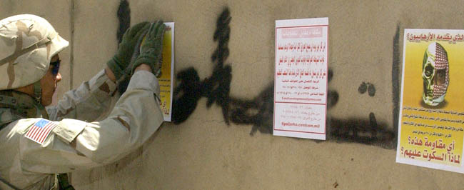 Iraq: Posters cover insurgent graffiti.