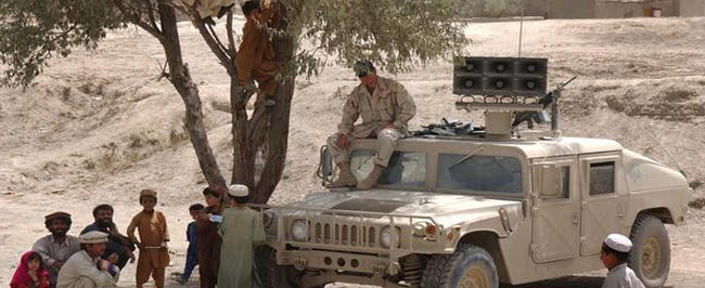 Operation Enduring Freedom: U.S. Army Sergeant sits atop his Humvee equipped with a loudspeaker system.