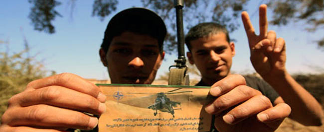 Libya 2011: Libyan civilians show off a leaflet that was released from NATO assets.